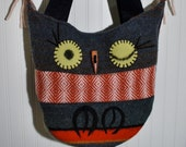 bookish bag with mismatch charm and pink ear tufts