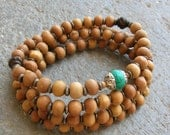 protection - 108 bead mala wrap bracelet , or necklace, sandalwood, African trade beads, and Tibetan Capped turquoise guru bead