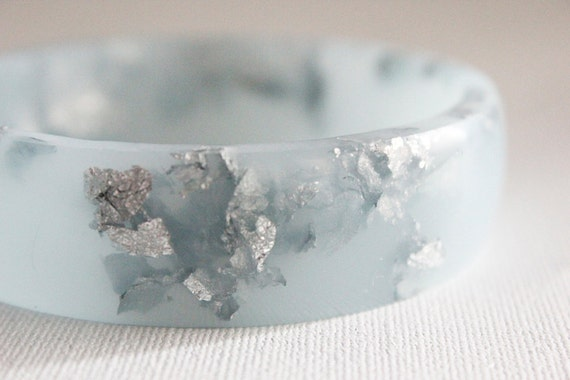 frost blue eco resin bangle bracelet with suspended silver leaf