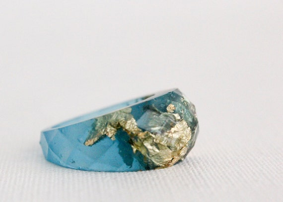ocean blue gold multifaceted eco resin ring with suspended gold flakes
