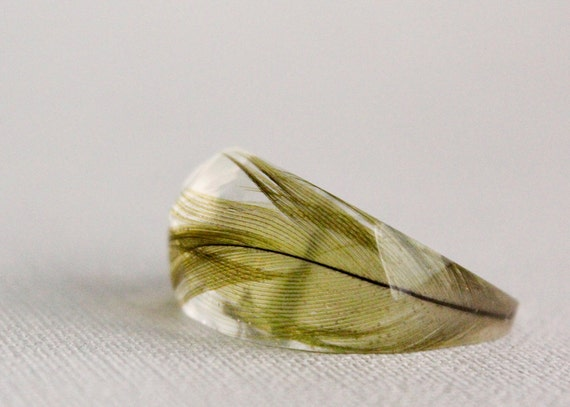 Sun conure parrot feather pointy eco resin ring with soft facets.