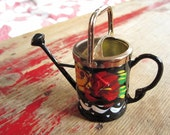 Miniature watering can, painted black and gold metal with red, green and yellow floral design, British, dollhouse spring gardening tool toy