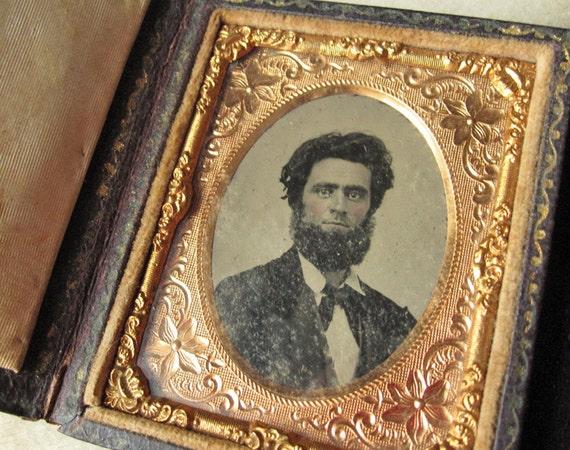 Tintype photograph portrait of bearded Civil War Era man, unusual leather case