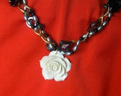 Woven Pearl and Hematite Necklace with a White Rose Pendant
