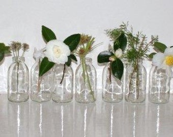 SPRING WEDDING DECOR.Eleven upcycled flower vases bottles.Great for weddings.Spring Celebrations.