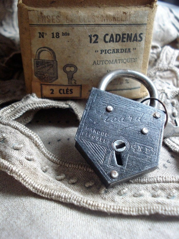 Old french black padlock with keys