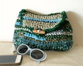 Green crochet clutch with recycled fabric scraps and wooden button