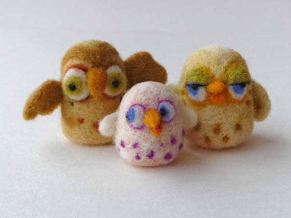 An owl family - needlefelted sculptures