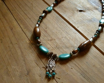 Silver, blue stone, and wooden beaded necklace