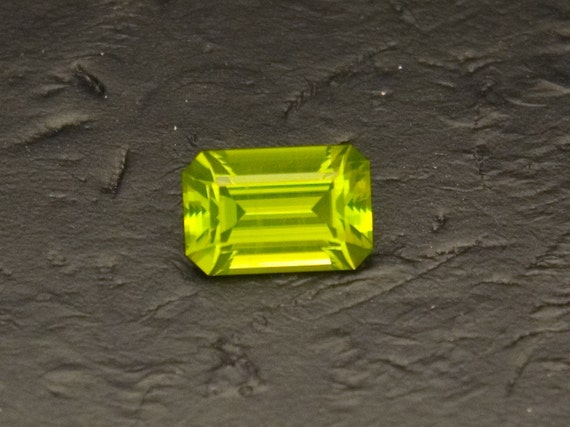 Apple Green Peridot -- 1.94 Carat Emerald Cut