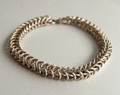 Chainmaille sterling silver box chain bracelet with natural patina.