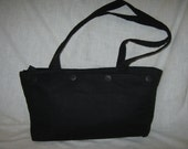 Black quilted purse with optional button on covers in many styles and colors.