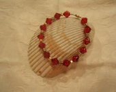 Ruby crackle bicone bracelet with gold