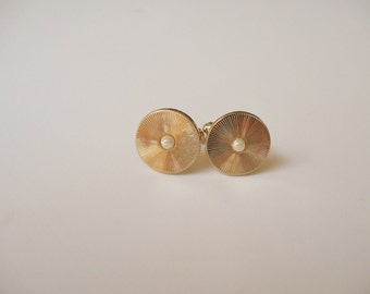 Gold Tone Cuffs with Pearl Center
