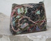 Cosmetic pouch - black beige taupe olive green red scraps threads vinyl covered quilted semi transparent eco friendly