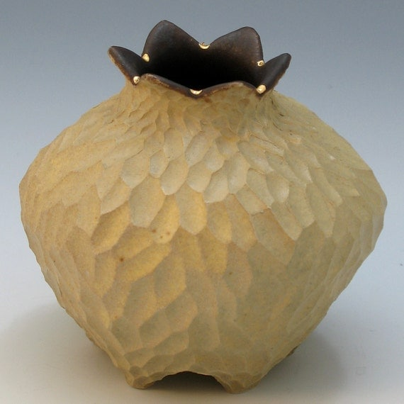 Tan & brown porcelain vessel with gold luster