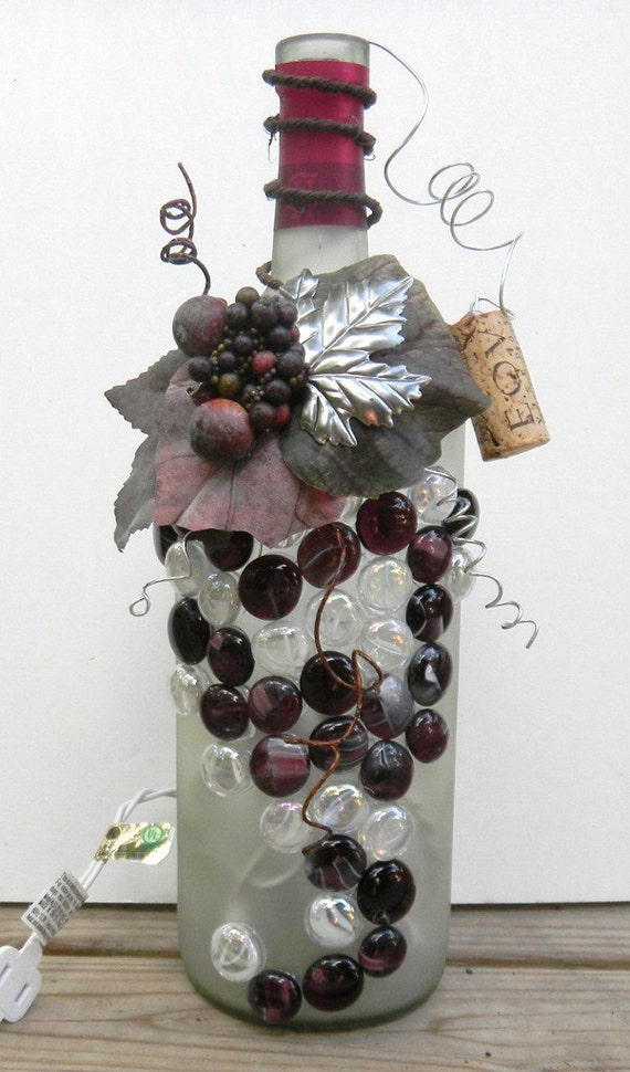 decorative embellished wine bottle light with leaves beads