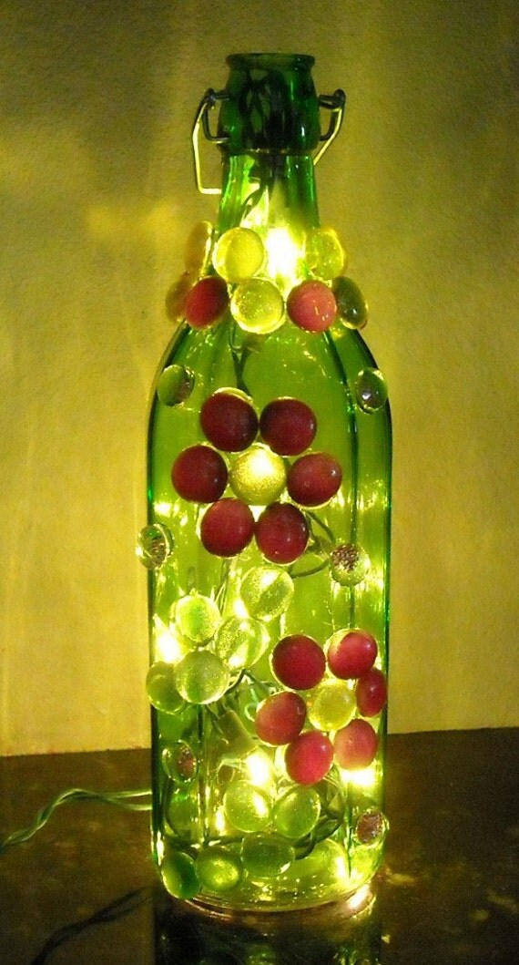 Items similar to green gold and purple floral themed for Glass bottles with lights in them