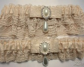 Garter set in champagne lace with Victorian style charms - Lacey Luxury