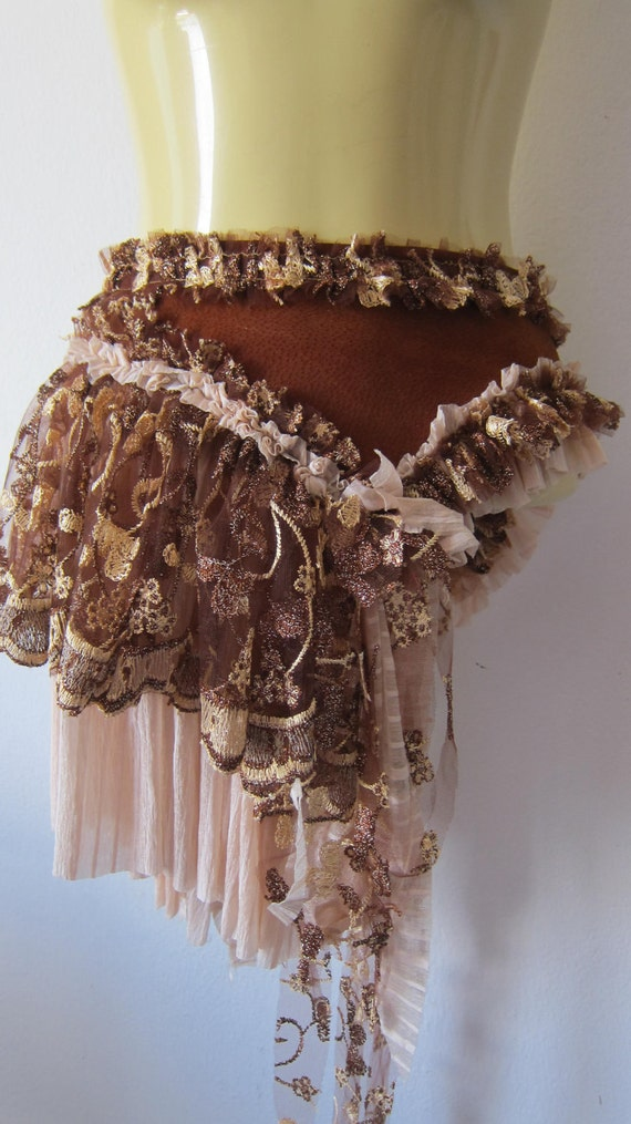 she's like a box of chocolates....brown suede bustle with ruffles of choc and milk lace...