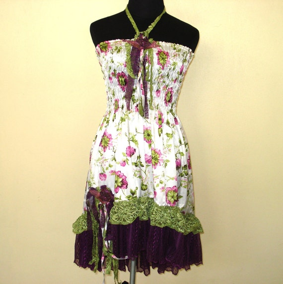 vintage inspired shirred babydoll style dress with ruffles of lace and vintage motifs...