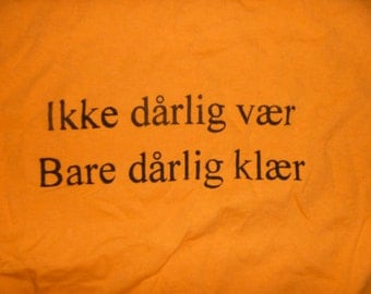"Norwegian Saying Shirt Roughly Translated: ""there's no bad weather, only bad clothing"" tangerine Adult Large"