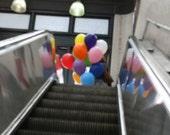 Balloons on an Escalator, photograph