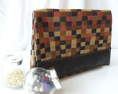 Clutch in soft leather and jewel toned chenille pattern
