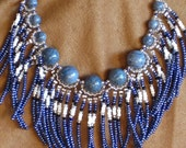 Native American style fringed necklace in blue, white and silver with blue sponge coral beads