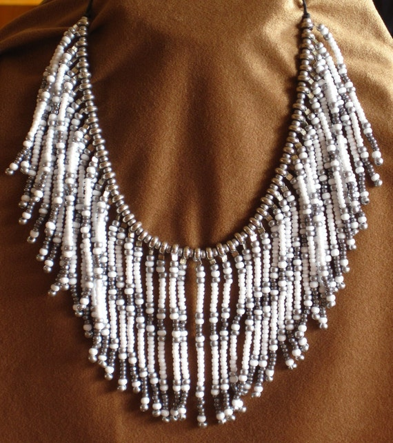 Native American style beaded fringe necklace in silver and white.