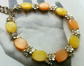 BSK Orange and Yellow Thermoset Rhinestone Daisy Necklace