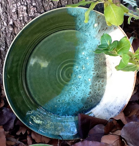 A Thrown Green and White Stoneware Plate