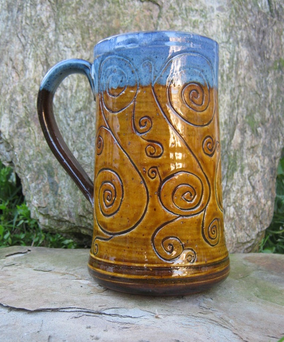 A Tan and Blue Spiral Tankard