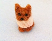 Tiny dollhouse scale yorkie or cat