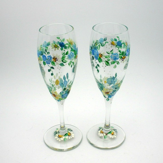 Hand painted pair of Champagne Flute wine glasses - three rings of various sized small blue roses - white daisies and baby breath