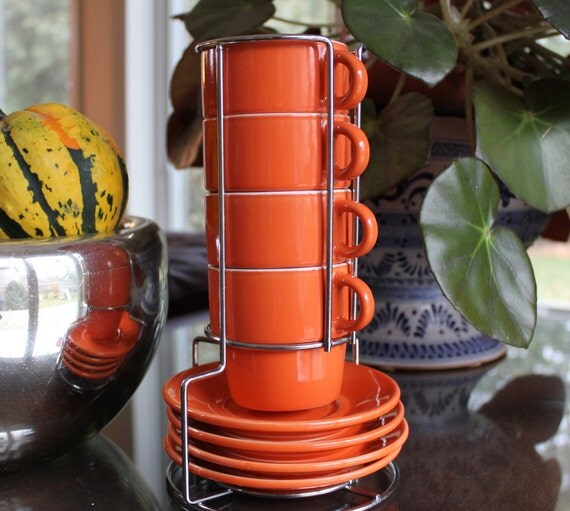 Set of Four Orange Mugs and Saucers in a Caddy