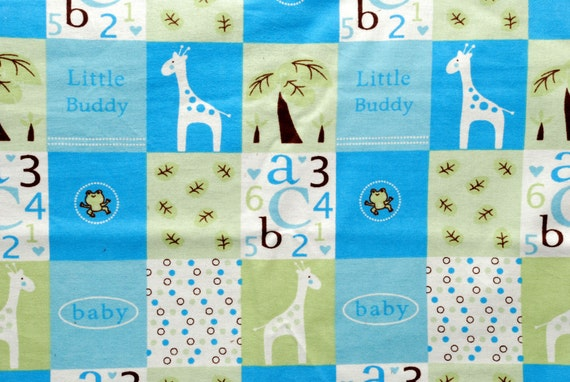 Precious baby boy blanket featuring giraffes, and brown minky backside.