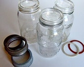 Three  fruit canning jars, glass lids and zinc bands