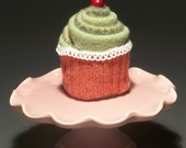 YUMcycled Cupcake:  Red Wrapper and Green Icing