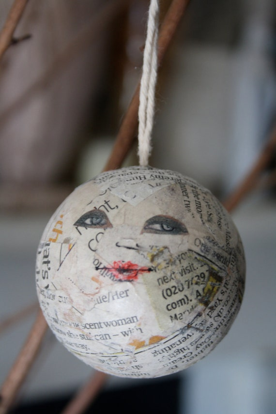 Face bauble,  newsprint collage