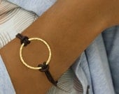 Oh -  bracelet with huge gold hammered circle and brown leather