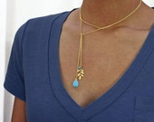 Balance Lariat Necklace/bracelet in gold. gold leaf with turquoise charm  Leaf necklace.