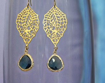 chandelier Filigree paisley earrings. Gold earrings with framed and faceted navy blue drop