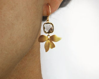 Angles and dangles. gold flower earrings. Square framed and faceted charcoal grey quartz with orchid flower