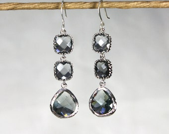 Angles and dangles. Two Squares and a teardrop, sparkly earrings, framed silver and grey faceted gems