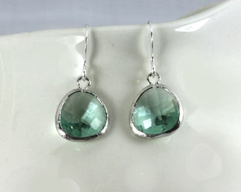Clear aqua earrings with silver bezel setting. Framed and faceted  erinite green earrings