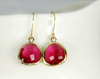Fuchsia red earrings with gold bezel setting. Framed and faceted berry pink earrings