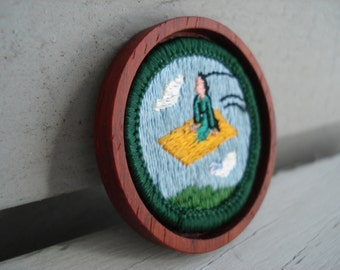 Vintage Girl Scout Flying Magic Carpet Badge in Mahogany Wood Bezel Setting Miniature Textile Artwork