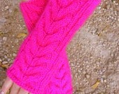 Hand knitted long cuff cable fingerless gloves in bright pink fuchsia color