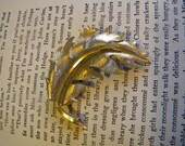 goldtone feather pin by Mamselle